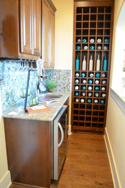 This is the wine/bar area with a pass through window to the formal dining room. Again, the beautiful colors of the tile and bottles.