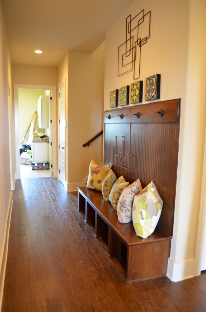 The door to the patio leads right through to the laundry room. It is the perfection location for this hall storage area.