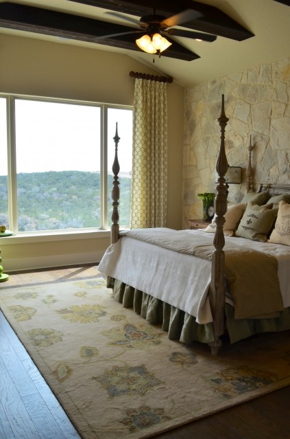 The colors in the trees in the hills are brought indoors in the gorgeous master bedroom.