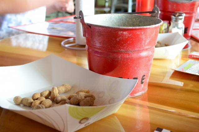 Complimentary roasted peanuts and a unique bucket to dispose of the shells!