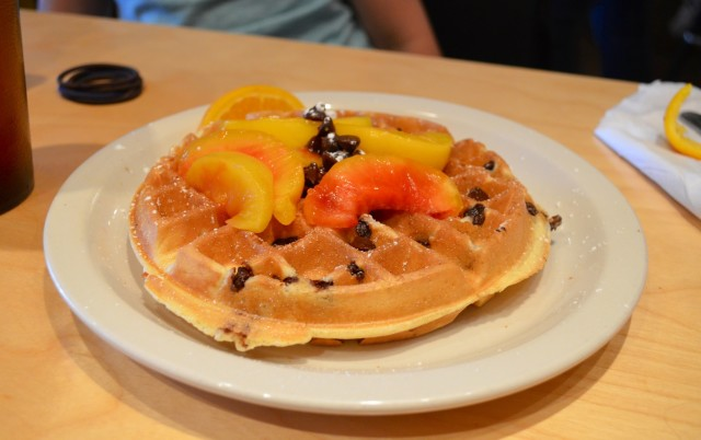 My daughter put her own twist on her order. Fresh peaches on a chocolate waffle.