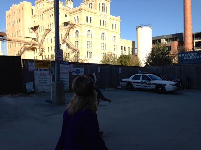 This is a great picture of construction and a police car and the Pearl.